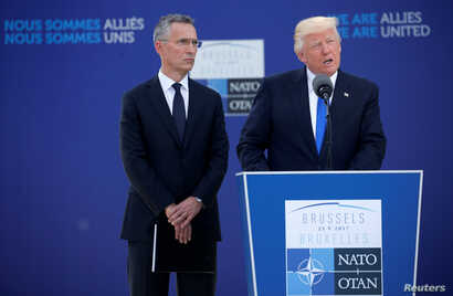 U.S. President Donald Trump speaks beside NATO Secretary General Jens Stoltenberg at the start of the NATO summit at their new headquarters in Brussels, Belgium, May 25, 2017.