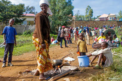 A refugee from the Democratic Republic of the Congo is seen with her children as they prepare a meal near the U.N. High Commissioner for Refugees offices in Karongi district, Rwanda, Feb. 21, 2018.