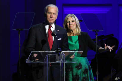 "FILE - Vice President Joe Biden, left, and Jill Biden speak at ""It Always Seems Impossible Until It Is Done: A Night of Music with ONE and (RED)"", in celebration of World AIDS Day, at Carnegie Hall."
