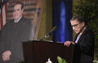 FILE - Supreme Court Justice Ruth Bader Ginsburg speaks at the memorial service for Supreme Court Justice Antonin Scalia, March 1, 2016, at the Mayflower Hotel in Washington.