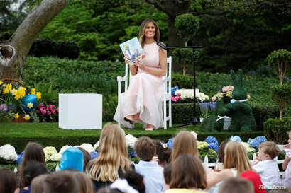 """U.S. first lady Melania Trump smiles after reading the children's book """"Party Animals"""" at the 139th annual White House Easter Egg Roll on the South Lawn of the White House in Washington, April 17, 2017."""