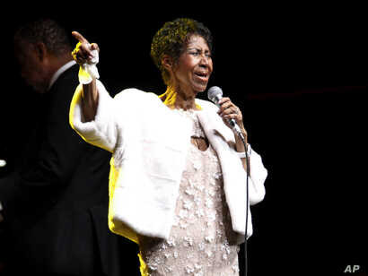 FILE - Aretha Franklin performs at the Elton John AIDS Foundation's 25th Anniversary Gala in New York, Nov. 7, 2017.
