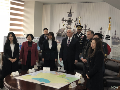 U.S. Vice President Mike Pence and his wife, Karen Pence, meet with North Korean defectors, Feb. 8, 2018, at Pyeongtaek, South Korea, at a memorial for the South Korean warship Cheonan, which was torpedoed by the North. Fred Warmbier, the father of O...