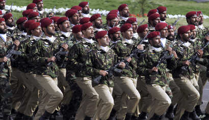 FILE - Pakistani commandos from the Special Services Group march during a military parade  in Islamabad, March 23, 2016.