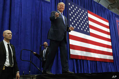 Republican presidential candidate Donald Trump arrives to speak at a campaign rally, Friday, Oct. 21, 2016, in Newtown, Pa.