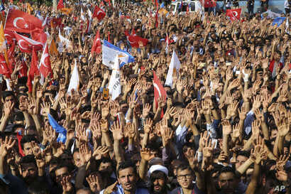Supporters react as they listen to Turkey's President and ruling Justice and Development Party leader Recep Tayyip Erdogan during an election rally in Adiyaman, Turkey, June 1, 2018.