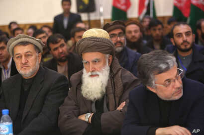 Former Afghan warlord Abdul Rasool Sayyaf, center, attends the inauguration of the Afghanistan Protection and Stability Council in Kabul, Afghanistan, Dec. 18, 2015.