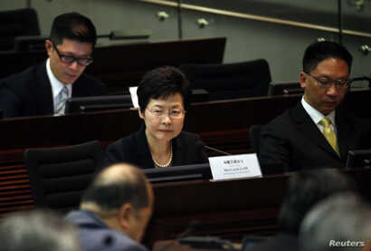 FILE - Hong Kong Chief Secretary Carrie Lam looks on during a meeting on proposing electoral reforms at the Legislative Council in Hong Kong.