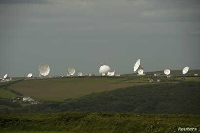 Satellite dishes are seen at GCHQ's outpost at Bude, close to where trans-Atlantic fiber-optic cables come ashore in Cornwall, southwest England, June 23, 2013. Britain's spy agency GCHQ has tapped fiber-optic cables that carry international phone an...