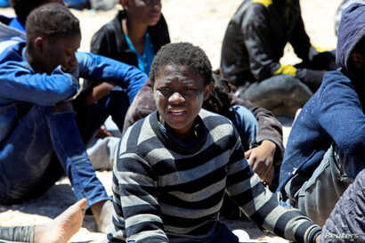 Migrants who'd attempted to flee to Europe wait in Libyan coast guard detention in the coastal city of Tripoli, Libya, May 16, 2016. The country's civil war has created openings for extremists, which Western governments hope to halt.