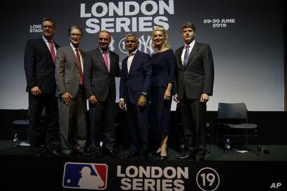 Tim Slavin of the Major League Baseball Players Association, left with John Henry owner of the Boston Red Sox, Robert D Manfred Commissioner of the MLB, Sadiq Khan the Mayor of London, Jennifer Steinbrenner Swindal and Hal Steinbrenner left with join...