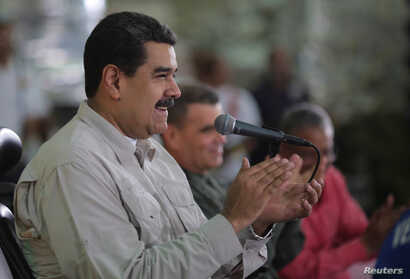 Venezuela's President Nicolas Maduro attends an event with workers in Caracas, Nov. 14, 2017.