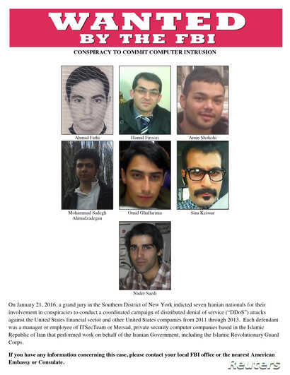 A most wanted poster provided by the FBI shows the Iranian hackers wanted for a coordinated campaign of cyber attacks in 2012 and 2013 on several U.S. banks and a New York dam, at the Justice Department in Washington, March 24, 2016.