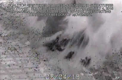 This image made from gun-camera video taken on July 4, 2015 and released by United States Central Command shows an airstrike on a bridge near Islamic State group-held Raqqa, Syria, that was a key transit route for the militants.