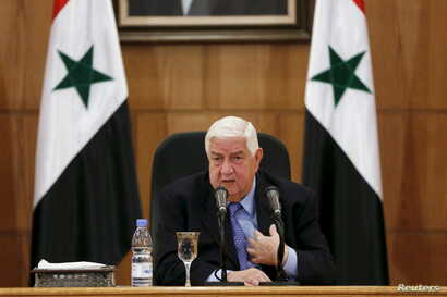 Syria's Foreign Minister Walid al-Moualem speaks during a news conference in Damascus, Syria, March 12, 2016.