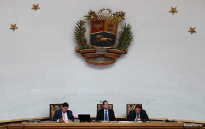 Venezuelan opposition leader and self-proclaimed interim president Juan Guaido attends a session of the Venezuela's National Assembly in Caracas, Jan. 29, 2019.