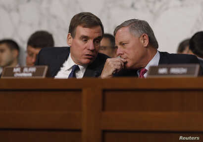 Senate Intelligence Committee ranking member Mark Warner (D-VA) (L) talks with Chairman Richard Burr (R-NC) during former FBI Director James Comey's appearance before a Senate Intelligence Committee hearing on Russia's alleged interference in the 201...