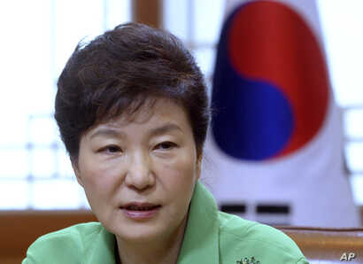 FILE - South Korean President Park Geun-hye speaks during a regular meeting at the presidential house in Seoul, South Korea.