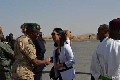 U.S. Deputy Ambassador to the United Nations Michelle Sison shaking the hand of a military commander is in Maroua, in northern Cameroon, where the Council met IDPs and refugees of the Boko Haram crisis.
