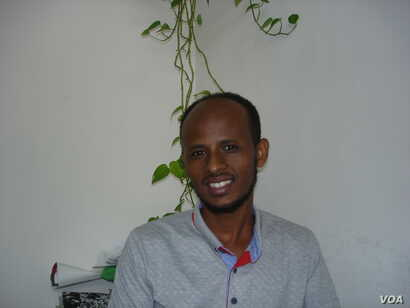 Solomon Gebreyohna, 29, of the village of Tselimkala in southern Eritrea wanted to go to Europe, was detained on the Libyan coast, and changed course to Israel where he is struggling to make ends meet. (J. Brilliant/VOA)