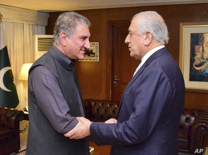 Photo released by the Foreign Office shows Pakistan's Foreign Minister Shah Mehmood Qureshi (L) receiving U.S. envoy Zalmay Khalilzad at the Foreign Ministry in Islamabad, Pakistan, April 5, 2019.