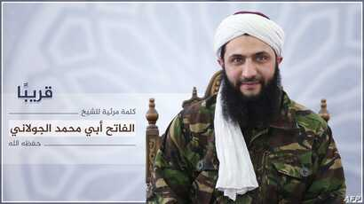 An image released July 28, 2016, by Al-Manara al-Bayda, the official news arm of Al-Nusra Front, al-Qaida's Syrian affiliate, allegedly shows the group's chief Abu Mohammad al-Jolani at an undisclosed location, in the first ever picture to be release...