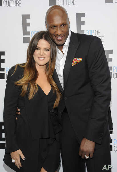 """FILE - TV personality Khloe Kardashian Odom and professional basketball player Lamar Odom from the show """"Keeping Up With The Kardashians"""" at an E! Network upfront event in New York, April 30, 2015."""