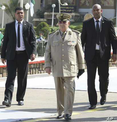 """Algerian chief of staff Gen. Ahmed Gaid Salah arrives to preside a military parade at the Cherchell """"Houari Boumediene"""" in Algiers, July 1, 2018."""