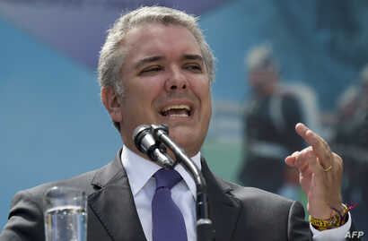 Colombian President Ivan Duque speaks during a ceremony for the recognition of command of the Military Forces at the Jose Maria Cordova Military School in Bogota, Dec. 17, 2018.