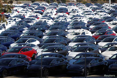 FILE - A parking lot of predominantly new Tesla Model 3 electric vehicles is seen in Richmond, California, June 22, 2018.
