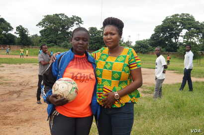 While in Malawi Mjeje's skills dazzled many people. In this photo she posed with Suzgo Ngwira, of the Malawi Women's Footaball Committee.
