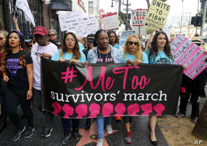 FILE - Participants march against sexual harassment and assault at the #MeToo March in the Hollywood section of Los Angeles, California, Nov. 12, 2017.