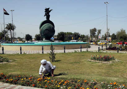 A gardener tends to flowers in Nisoor Square, the site of a deadly shootout by Blackwater private security contractors in 2007, in Baghdad, Iraq, April 15, 2015.