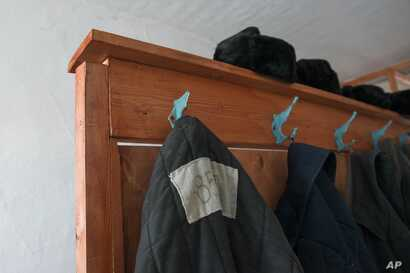 FILE - Prisoners' clothes are seen in a museum at a now defunct Soviet-era prison camp near the Siberian city of Perm, Russia, March 6, 2015. To some, the reintroduction of forced labor in Russia signals a return to the notorious Gulag prison system....