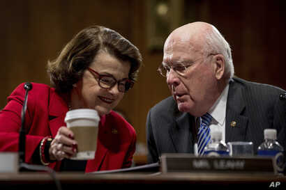 Sen. Dianne Feinstein, D-Calif., talks to Sen. Patrick Leahy, D-Vt., on Capitol Hill in Washington during the Senate Judiciary Committee's business meeting to discuss the nomination of Attorney General-designate Sen. Jeff Sessions, R-Ala., Jan. 31, 2...