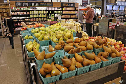 In this May 3, 2017, photo, fresh fruit is displayed in a Whole Foods Market grocery store, in Upper Saint Clair, Pennsylvania.
