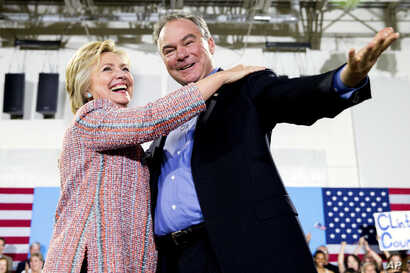 In this July 14, 2016, file photo, Democratic presidential candidate Hillary Clinton, accompanied by Sen. Tim Kaine, D-Va., speaks at a rally at Northern Virginia Community College in Annandale, Va. Clinton chose Kaine to be her running mate. (AP Pho...