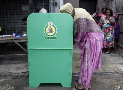 FILE - A woman casts her vote during a local government election in Lagos, Nigeria, July 22, 2017. Nigerian women fear being sidelined in the country's 2019 general elections due to discrimination, a lack of will from political parties and a shortage