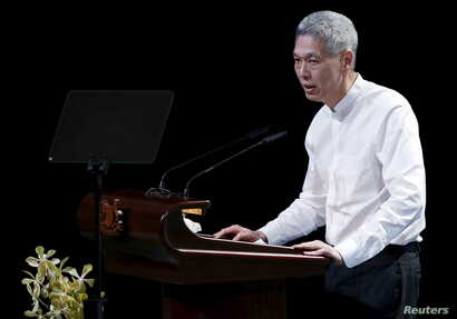 Lee Hsien Yang, son of former leader Lee Kuan Yew, delivers a eulogy for his late father, during the funeral service in Singapore, March 29, 2015.