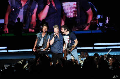 Joe Don Rooney, Gary LeVox, and Jay DeMarcus of Rascal Flatts Performs at Aarons Amphitheater on June 6, 2013, in Atlanta.