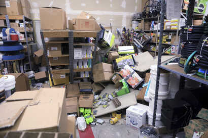 Items from two shelves that came unbolted from a wall are strewn across the floor of the stockroom of Anchorage True Value Hardware following an earthquake, Nov. 30, 2018, in Anchorage, Alaska. Store owner Tim Craig says no one was injured but hundre...