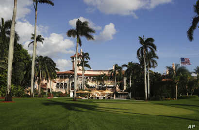 Mar-a-Lago is seen from the media van window in Palm Beach, Fla. Trump has described the sprawling Mar-a-Lago property as the Winter White House and has spent two weekends there this month.