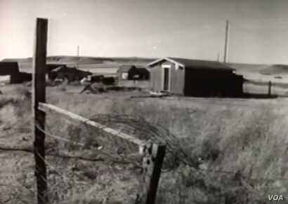 """This screenshot from the 1958 NBC documentary """"The American Stranger"""" shows the impoverished community of landless Cree and Chippewa Indians known as Hill 57, outside Great Falls, Montana."""