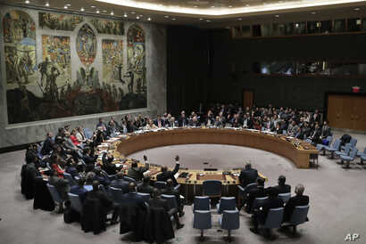 Members of the Security Council vote after presentations for a resolution for an independent investigation on the use of chemical weapons in Syria during a Security Council meeting, April 10, 2018, at United Nations headquarters.