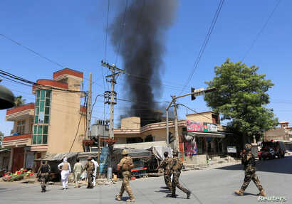 Smoke rises from an area where explosions and gunshots were heard, in Jalalabad city, Afghanistan, July 31, 2018.