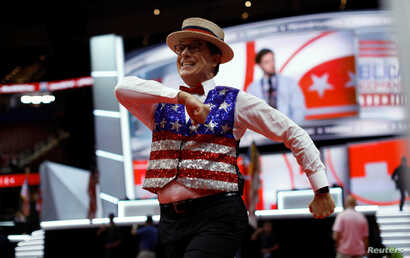 FILE - Tonight Show host Stephen Colbert records a skit on the floor of the Republican National Convention in Cleveland, Ohio, July 17, 2016. Colbert is known to use his show to regularly roast President Donald Trump and members of his administration...