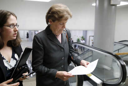 Sen. Jeanne Shaheen, D-N.H., right, arrives with an aide for a vote on Gina Haspel to be CIA director, on Capitol Hill, May 17, 2018 in Washington.