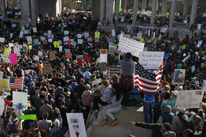 Thousands gather at Denver's City Center Park for a rally in support of the Muslim community and to protest President Donald Trump's executive order to temporarily ban some refugees from seven mostly Muslim countries, in Denver, Feb. 4, 2017.