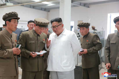 North Korean leader Kim Jong Un gives field guidance during his visit to a machine factory under the Ranam Coal Mining Machine Complex in this undated photo released by North Korea's Korean Central News Agency in Pyongyang, July 17, 2018.
