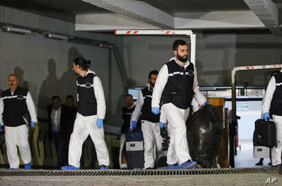 Turkish police crime scene investigators leave an underground car park, after looking for possible clues into the killing of Saudi journalist Jamal Khashoggi, on a vehicle belonging to the Saudi Consulate found by authorities a day earlier, in Istanb...